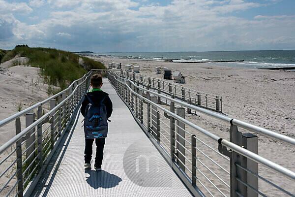 Boy, sea and beach