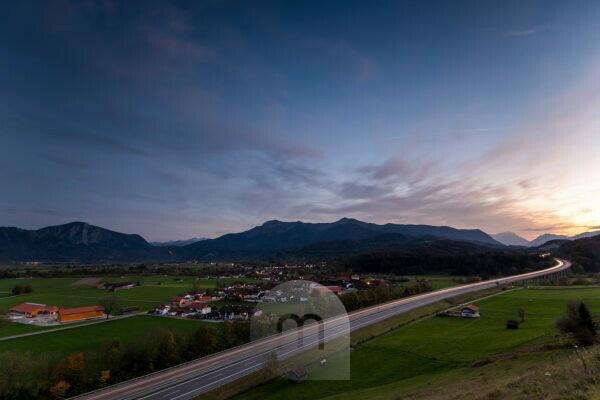 View of the motorway to Garmisch-Partenkirchen and the Zugspitze, as well as Kesselberg, Herzogstand, Heimgarten and the Bavarian Prealps of the Ester Mountains in the evening.