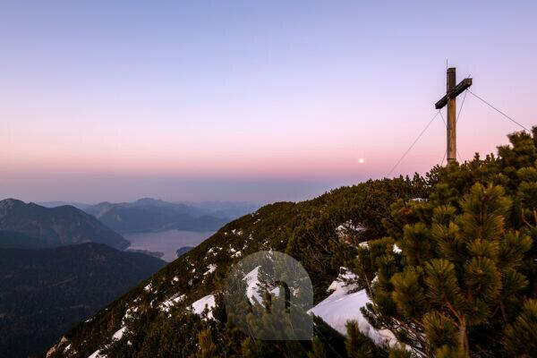 Simetsberg summit cross and in the background Karwendel, Walchensee and Estergebirge with full moon in the evening after sunset