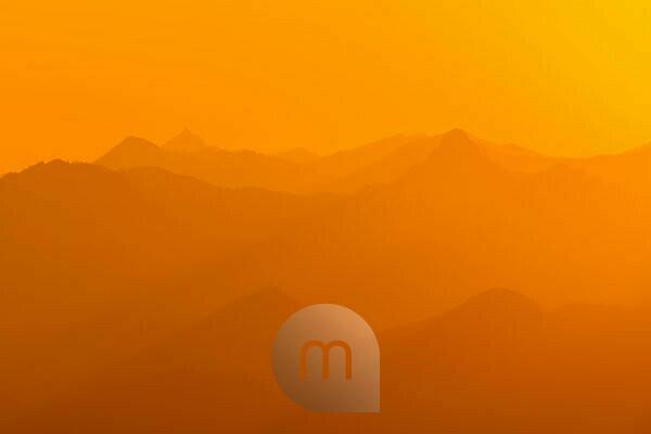 Golden light from sunrise over the Rofan mountains