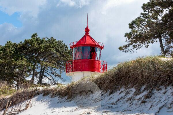 Germany, Mecklenburg-West Pomerania, Hiddensee, old lighthouse Gellen on a grass dune. Sunny summer day. Beautiful blue sky with clouds in the background, Baltic Sea.