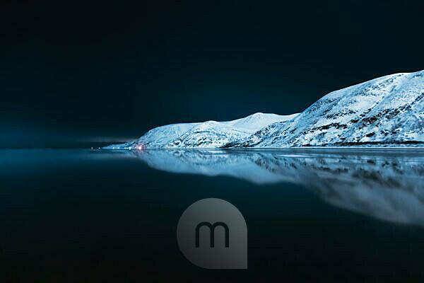 Mountain chain reflecting in Tanafjorden, Suoidnesuolu, Tana, Norway