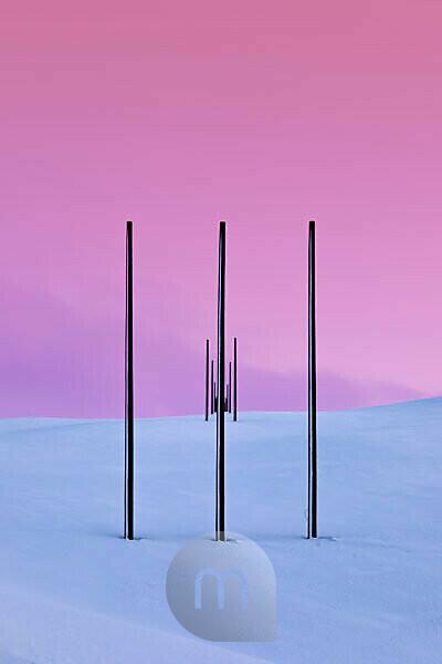 Power pylons in winter landscape, Tana, Norway