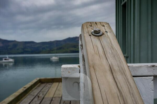 Wooden handle on the jetty in Akaroa harbor