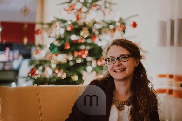 Germany, Bavaria, Christmas, Silent Night, 24. December, Christmas festival, Tree, Evening, woman smiling in front of christmas tree,