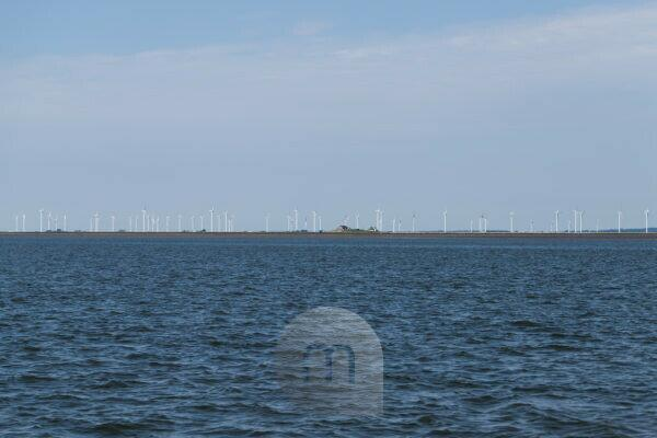 Solitude and tides - houses and wind turbines in the Wadden Sea