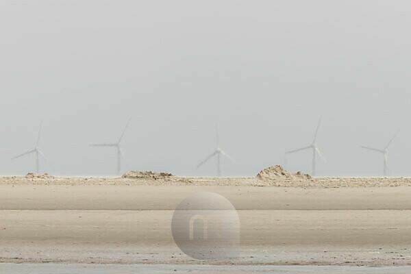 Fata Morgana on the Wadden Sea - Shimmering light - View over the beach on the Wadden Sea to the wind turbines on the horizon.