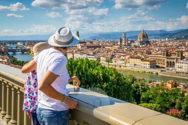 two tourists (mother and daughter) are admiring the historic center of Florence, elevated view from the panoramic point of piazzale michelangelo, Florence, Tuscany, Italy, Europe