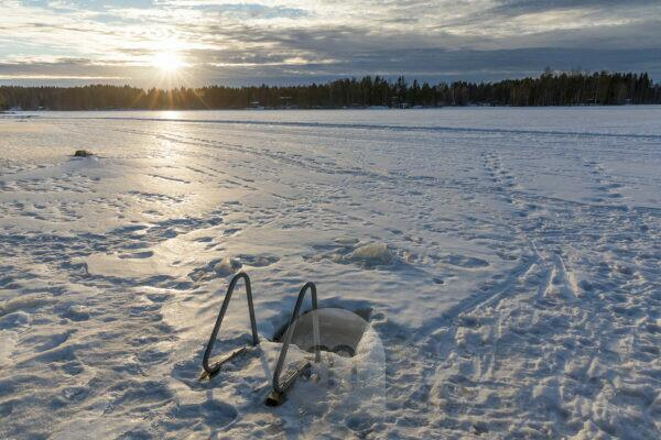 Finland, ice hole for taking a bath in winter