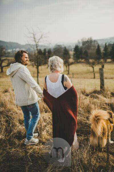 Alternate, tattooed couple, walk with their dog,
