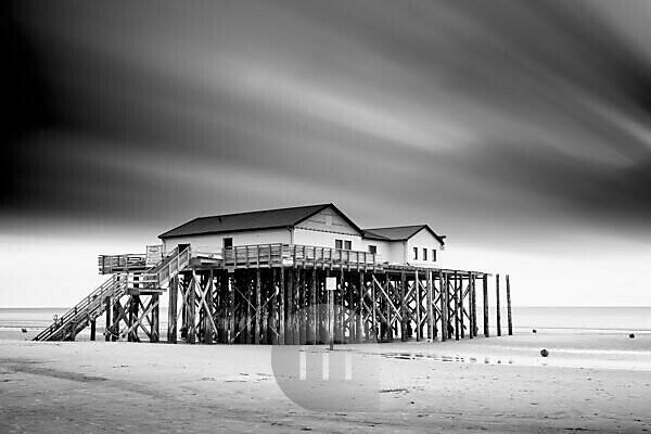 stilt houses on the beach of Saint Peter Ording, peninsula Eiderstedt, Schleswig Holstein, Germany