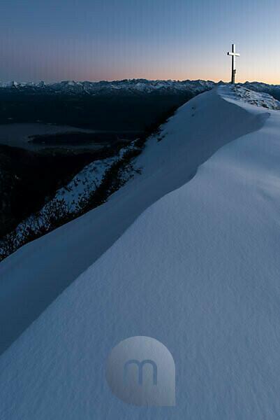 Evening sun at the summit of the Heimgarten, summit cross shines silver.