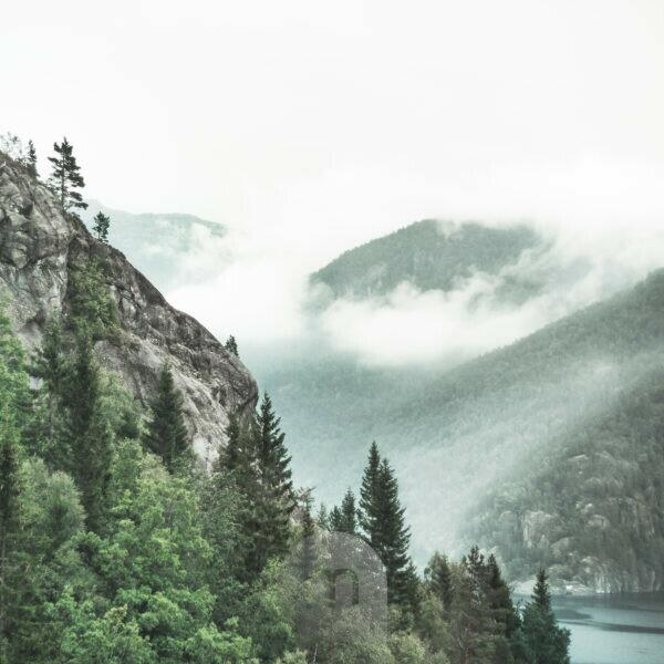 Fog patches in typical fjord landscape, Norway, Scandinavia