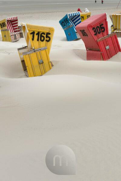 Germany, Lower Saxony, Eastern Friesland, beach chairs on the East Frisian island Langeoog after a storm.