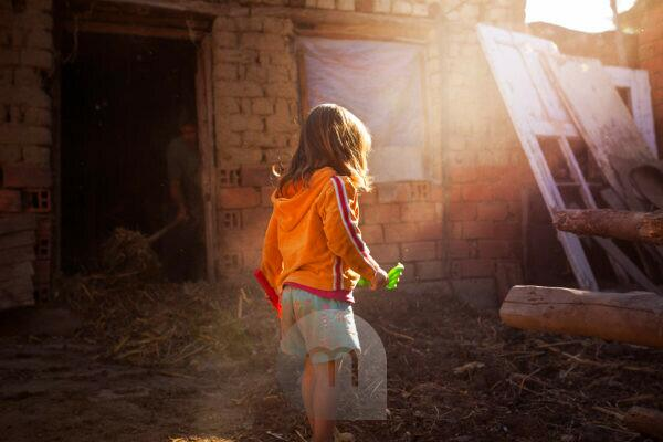 4-6 years old child playing in old shed,