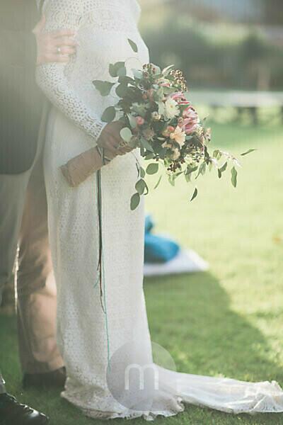 Alternate bridal couple outside, detail