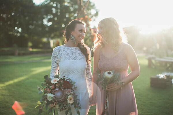 Bride and witness at alternative wedding outside, half portrait
