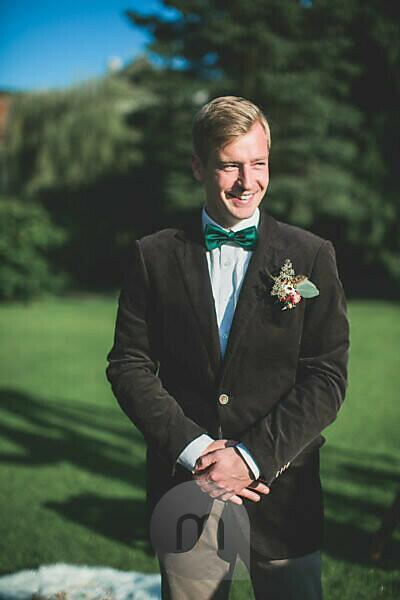 Bridegroom at wedding ceremony outside, half portrait