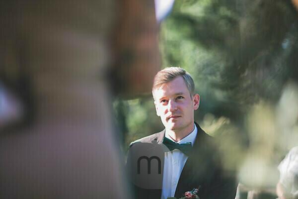 Bridegroom at wedding ceremony outside, portrait