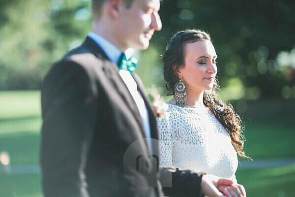 Alternate bridal couple outside, portrait