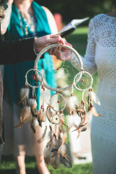 Alternate bridal couple at wedding ceremony outdoors, ceremony, dream catcher, detail