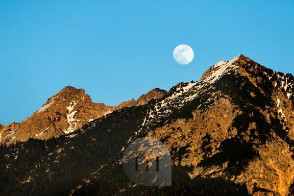 Moonrise above the Soiern group in the Karwendel Mountains of the Bavarian Alps, Germany.