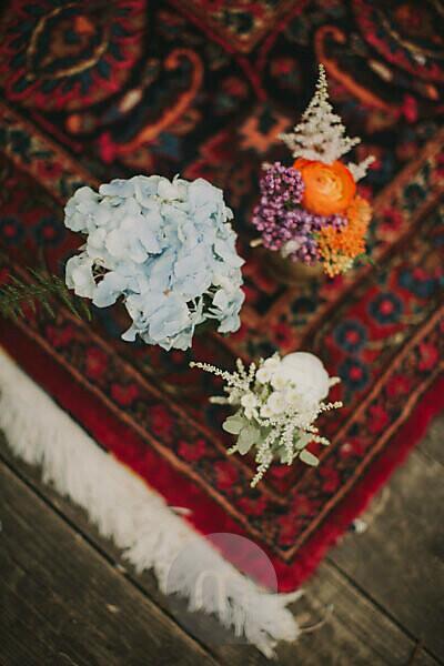 Floral decoration on carpet at alternative wedding celebration, close up