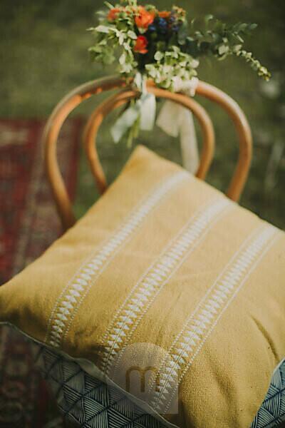 Alternative wedding, decoration, chair, flowers, cushions, medium close-up
