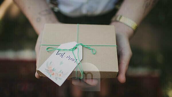 Alternative wedding, guest hands present, medium close-up, detail