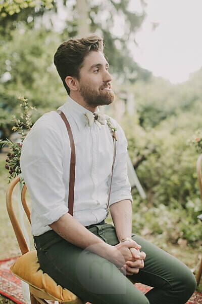 Alternative wedding outside, groomsman traces the ceremony