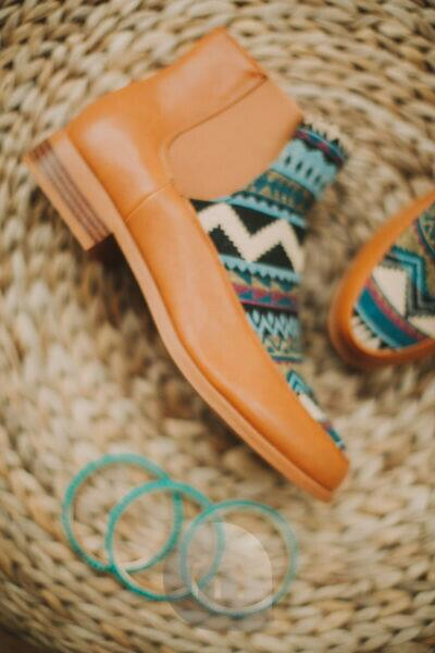 Women's shoes with Ethno pattern, bangles, still life