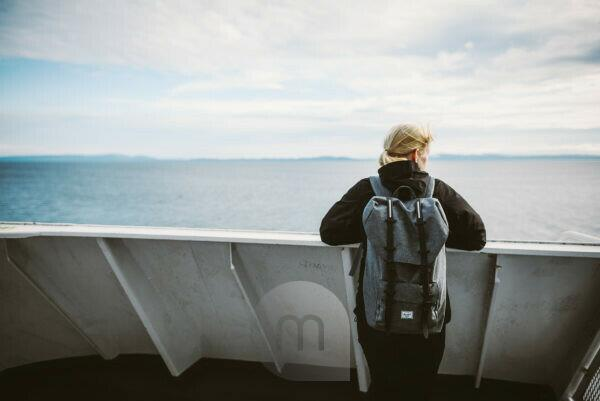 Woman on a ferry, looking into the distance, Vancouver Island, Canada