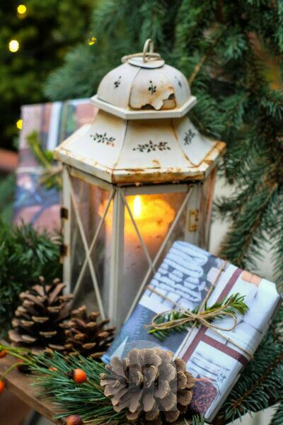 Christmassy still life with old lantern and presents - decoration garden, balcony, terrace