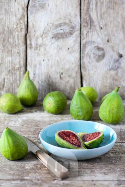 Still life with fresh green figs on old wood