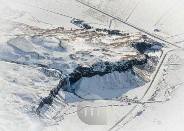 Seljalandsfoss waterfall in the winter, aerial shot from a Cessna