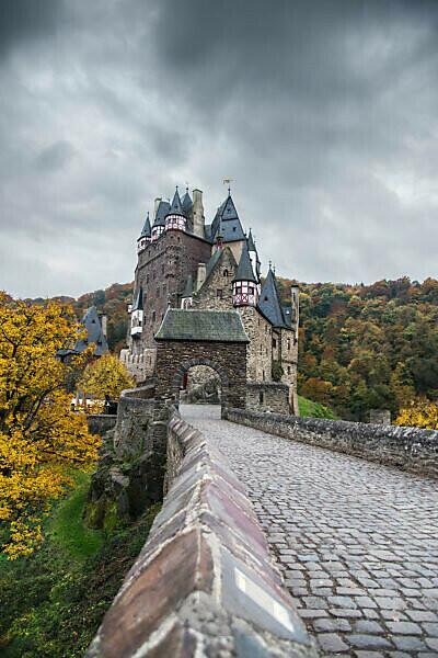 The autumnal castle Eltz in cloudy sky.
