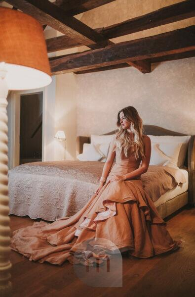 Woman, evening dress, bed, sitting,