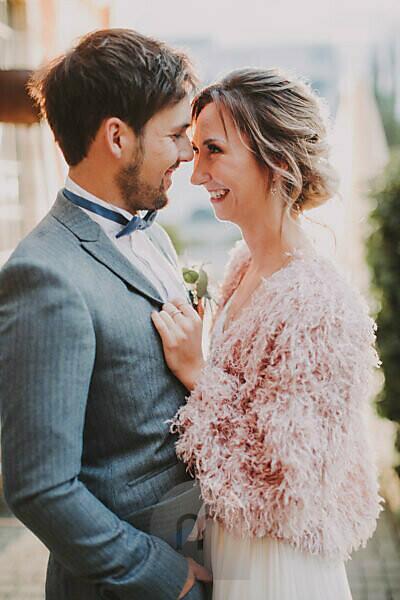 Bridal couple in love, smiling, half portrait,
