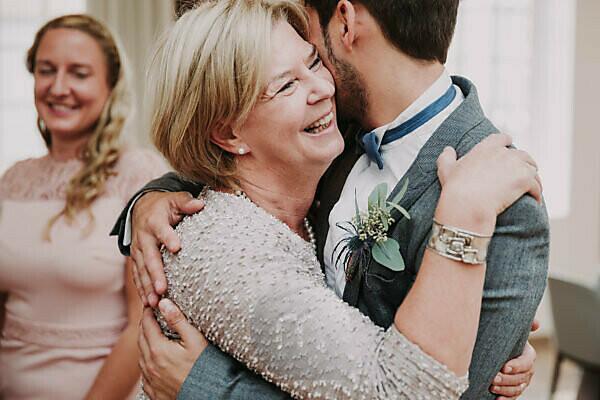 Wedding, groom and senior woman, hug, smile,