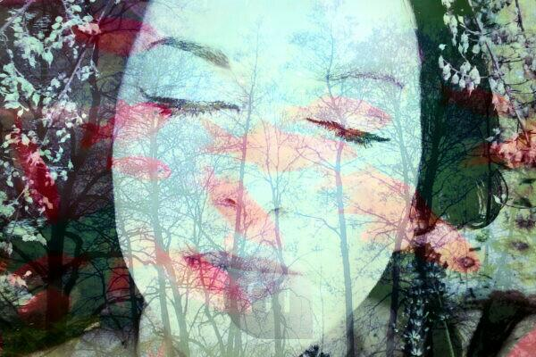 Portrait of a woman overlaid with branches and flowers,