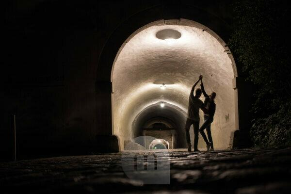 Dancing silhouettes in a tunnel