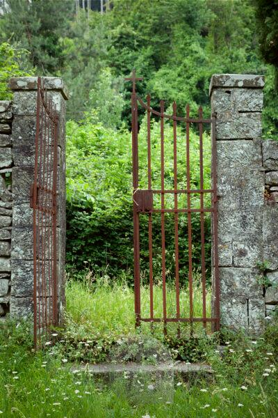 Gate, cemetery, Tuscany, Italy