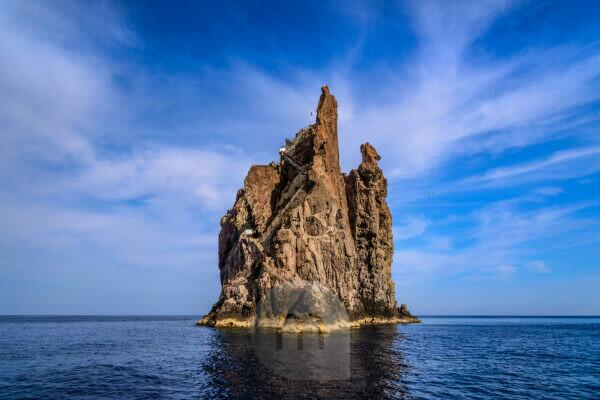 Italy, Sicily, Aeolian Islands, Stromboli, Strombolicchio rock island, view from a boat