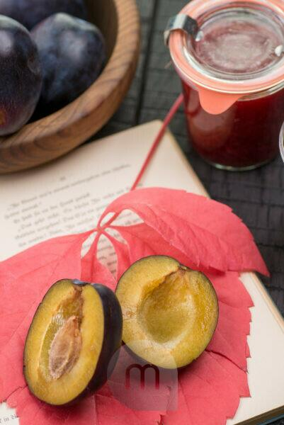 opened book, autumn leaf, plums and stewed plums