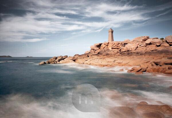 Pink Granite Coast with impressive pink granite rocks and Phare de Ploumanac'h lighthouse