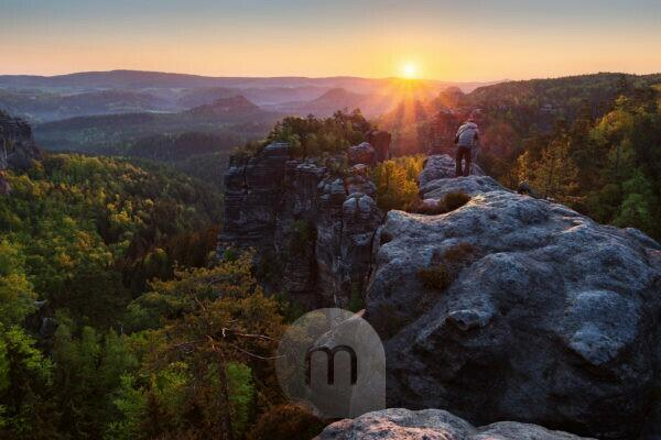 Photographer on the herring stone at sunrise, Elbe Sandstone Mountains, Saxony, Germany