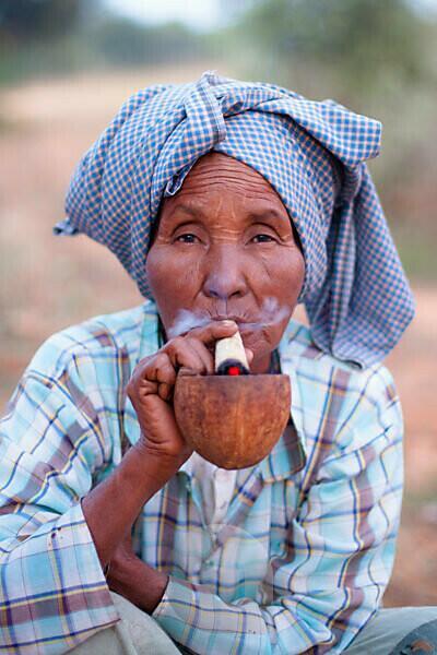 Old Burmese woman smoking in Bagan, Myanmar
