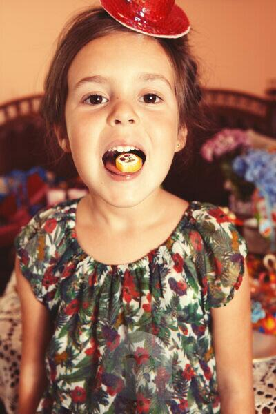 Party Girl with candy on her outstretched tongue