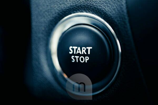 The start stop button of a car. Symbol for Begin and end, drive, engine and beginning.