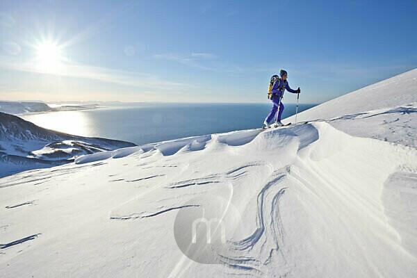Mountaineer on ski tour in Akureyri, Fjord Eyjafjördur, Nordland, Iceland
